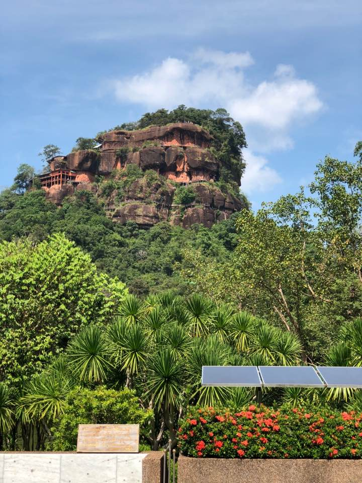 "Wat Phu Thok is one of the region's wonders. Phu Thok (which means ""Lonely Mountain"" in the Isaan dialect) has two peaks: Phu Thok Yai and Phu Thok Noi,"